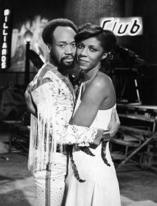 Promotional portrait of American singers Maurice White Natalie Cole embracing for Cole's television special, 1978. (Photo by Frank Edwards/Fotos International/Getty Images)
